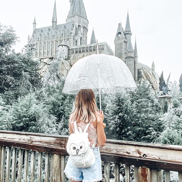 rainy days on campus..🌩 - there's nothing i love more than spending the day here with a butter beer in one hand and my wand in the other ♡ happy 30th birthday to @universalorlando — thank you for making the college of witchcraft and wizardry come to life 🧙♂️ - BIG NEWS!! harry potter masks will be arriving to the parks by the end of the month, and i will DEFF be purchasing one to rep my slytherin pride 🐍 which hogwarts house are you in?? let me know in the comments down below 👇🏻